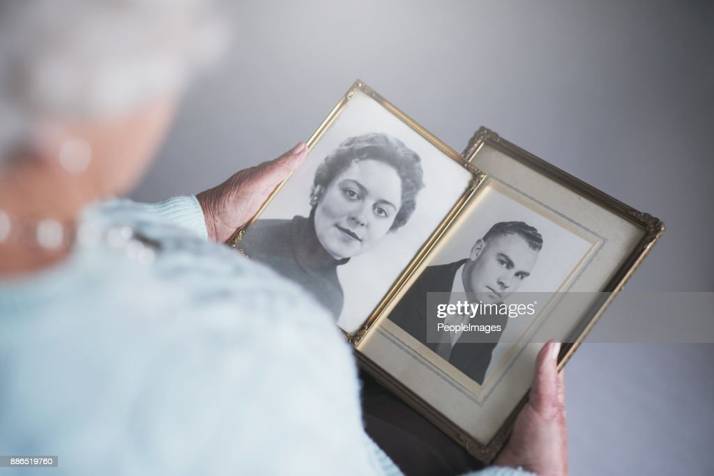 Looking through snapshots from the past : Stock Photo