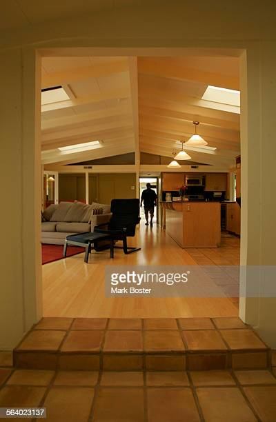 –Looking through the entryway into the living room kitchen and dining area Homeowner Robert Burgeno takes pride in his Cliff May designed ranch home...