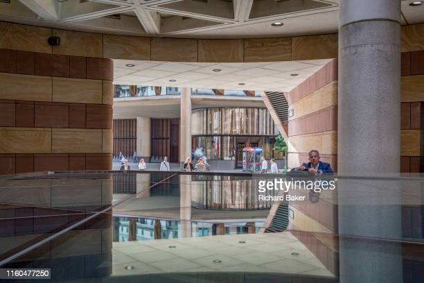 Looking through the open architecture at number 1 Poultry towards the Bloomberg Building on Great Victoria Street in the City of London the capital's...
