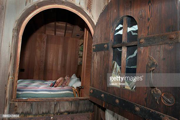 Looking through the open window of a bedroom in the guesthouse of a home in Carmel California