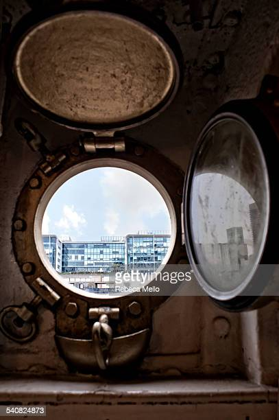 Looking through the window of Fragata Sarmiento Ship Museum moored in the Rio de la Plata It is seen a part of the modern buildings of Puerto Madero...