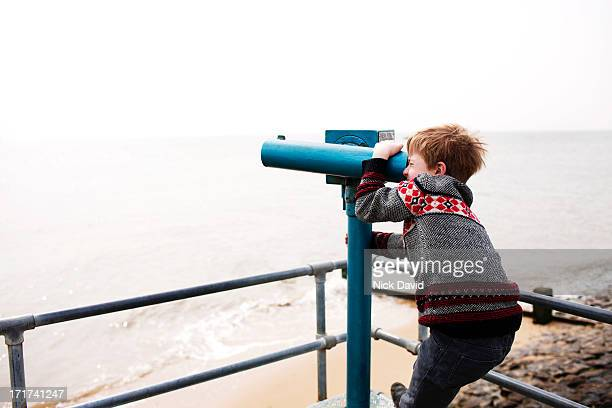 looking through viewpoint binoculars - binoculars stock pictures, royalty-free photos & images