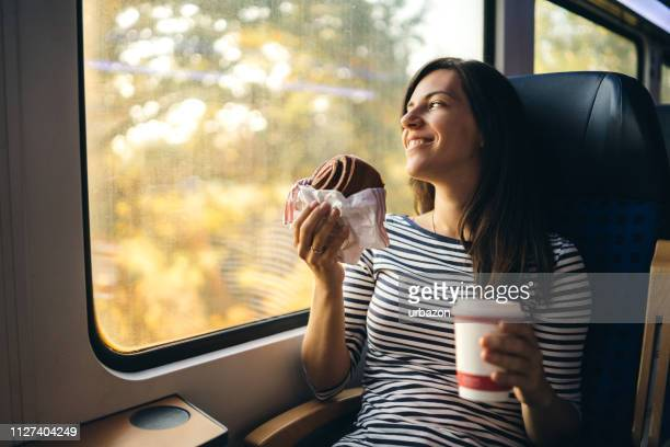 looking through window on a train ride - public transport stock pictures, royalty-free photos & images