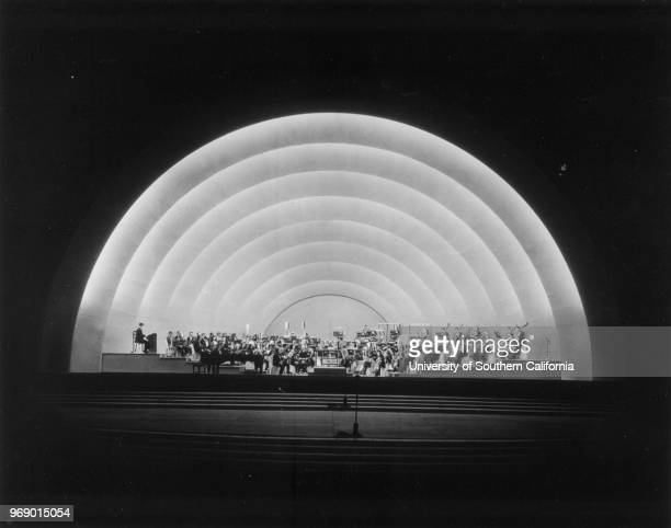 Looking toward the orchestra during a nightime concert at the Hollywood Bowl Los Angeles California early to mid twentieth century