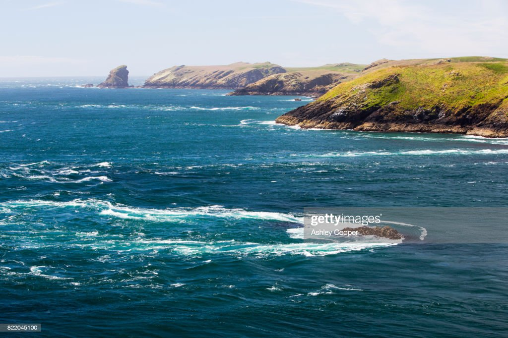 Looking towards Skomer Island from Wooltack Point, Pembrokeshire, Wales, UK, with a raging tidal race. : Stock Photo