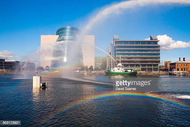 CONTENT] Looking towards the Convention Centre in Dublin with several rainbows in front of it