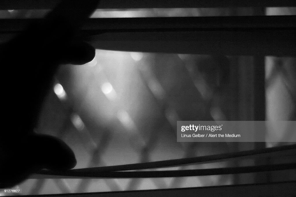 Looking trough a backlit window : Stock Photo