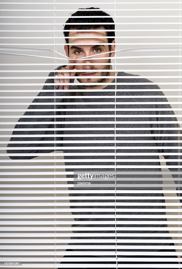 Looking trough the blinds. : Stock Photo