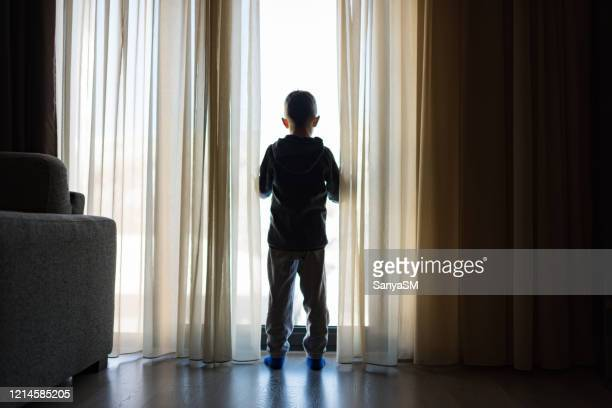 looking trough the window - lockdown stock pictures, royalty-free photos & images