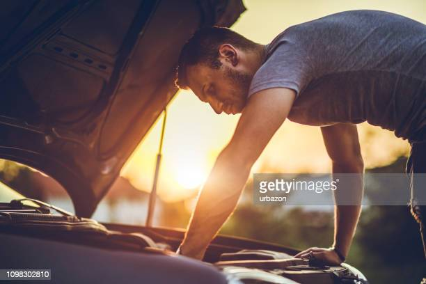 looking under car hood - stranded stock photos and pictures