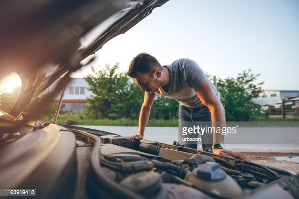 looking under car hood - car repair stock pictures, royalty-free photos & images