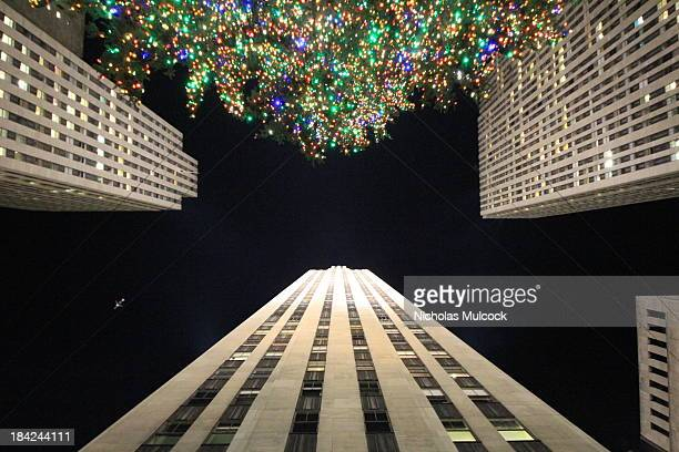 "Looking up ""30 Rock"" in Rockefeller Center, New York City, during the holidays. The Rockefeller Center Christmas Tree also stretches to the sky where..."