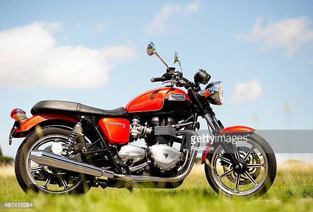 looking up at a 2012 triumph bonneville motorcycle against sky. - triumph motorcycle stock pictures, royalty-free photos & images