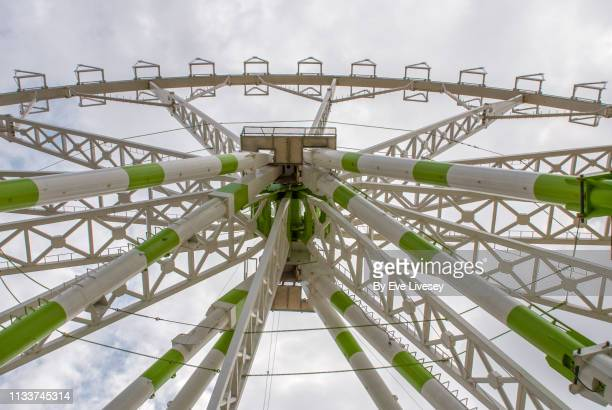 looking up at a ferris wheel - asymmetry stock pictures, royalty-free photos & images