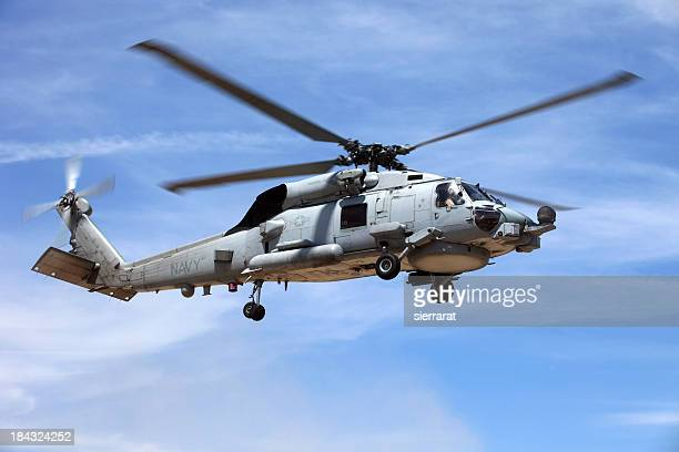 looking up at a seahawk helicopter flying in blue sky - navy stock pictures, royalty-free photos & images