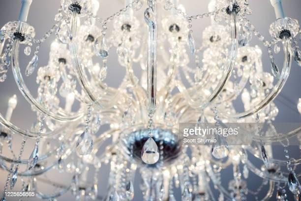 looking up at an illuminated chandelier - ボールルーム ストックフォトと画像