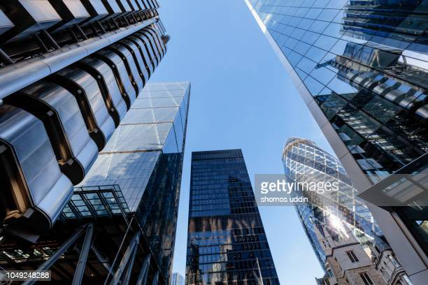 looking up at futuristic city skyscrapers in london - capital cities stock pictures, royalty-free photos & images