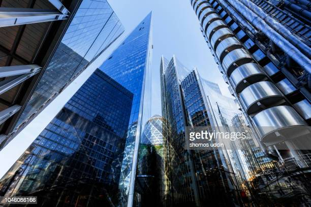 looking up at futuristic london skyscrapers - multiple exposure - financial district stock pictures, royalty-free photos & images