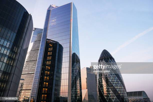 looking up at futuristic london skyscrapers - financial district stock pictures, royalty-free photos & images
