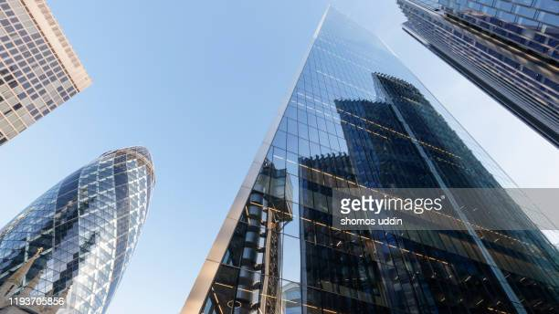 looking up at futuristic london skyscrapers - skyscraper stock pictures, royalty-free photos & images