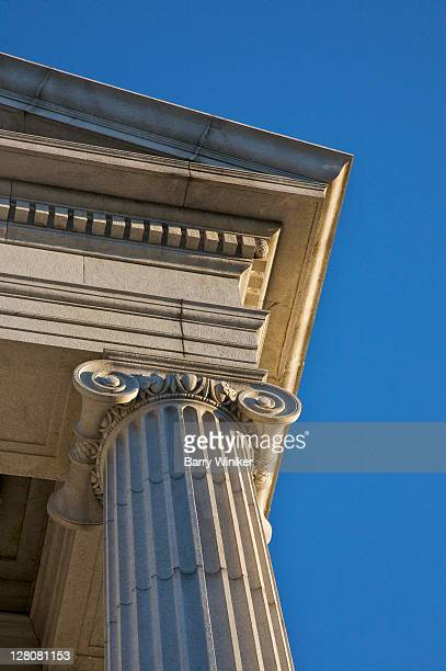 Looking up at Ionic column, dentils and pediment edge at main entrance to Minneapolis Institute of Arts, Minneapolis, Minnesota, Midwest, USA