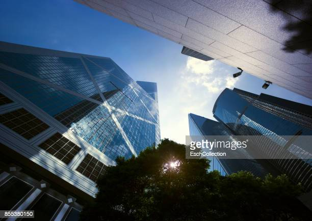 looking up at modern office buildings in hong kong - bank financial building stock pictures, royalty-free photos & images