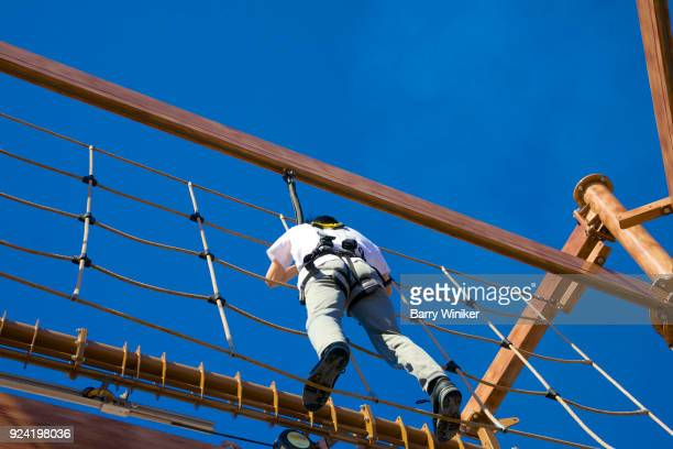 Looking up at person on ropes course on cruise ship