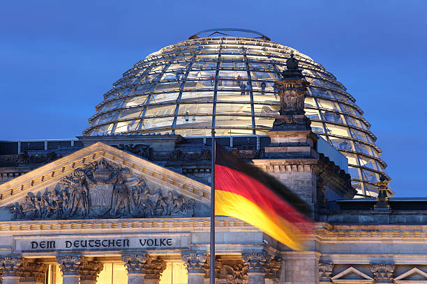 looking up at reichstag dome illuminated - germany stock pictures, royalty-free photos & images