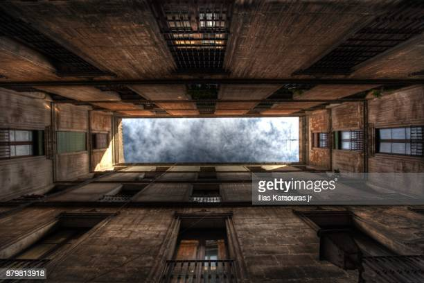 Looking up at sky through opening in neoclassical building, Passatge de la Pau