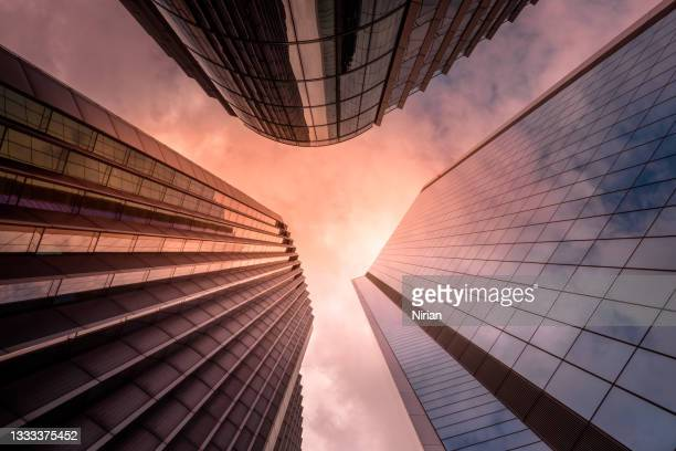 looking up at skyscrapers - headquarters stock pictures, royalty-free photos & images