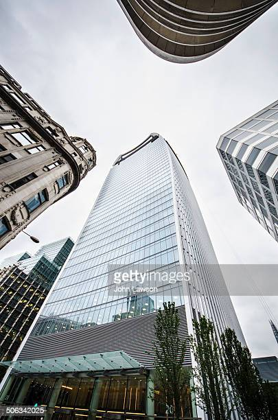 Looking up at tall buildings in Fenchurch Street in the City of London, England, UK. The tallest building in the image is 20 Fenchurch Street,...