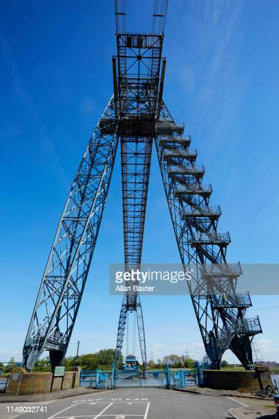 looking up at the 'newport transporter bridge' in newport - newport wales photos stock pictures, royalty-free photos & images