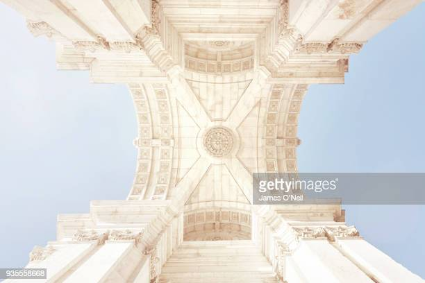 Looking up at the underside of an ornate triumphal arch, Arco da Rua Augusta, Lisbon, Portugal