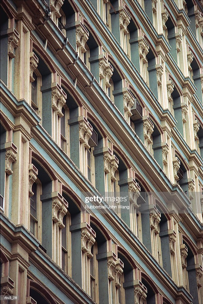 looking up diagonally at window arches and ledges from baroque style buildings : Foto de stock