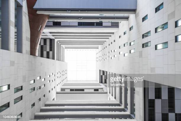 looking up from the atrium of a highrise building - viewpoint stock pictures, royalty-free photos & images