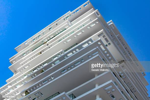 Looking up from the feet of the building