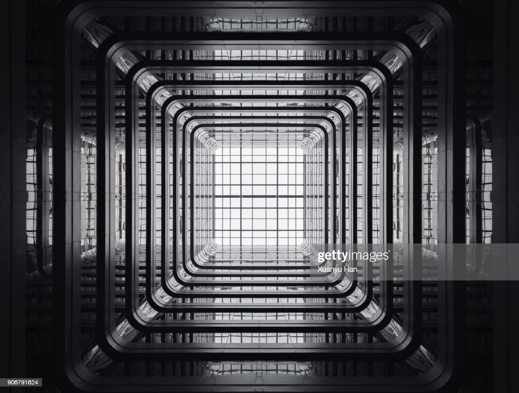 Looking up from the patio of a public apartment building. : Foto de stock