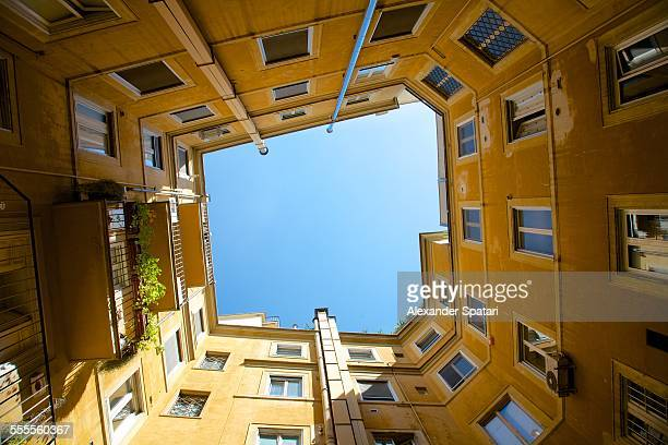 Looking up in the old open courtyard in Rome