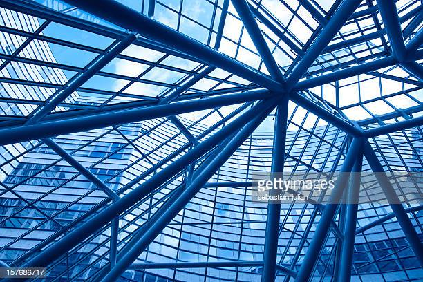 looking up into modern glass and steel business facade