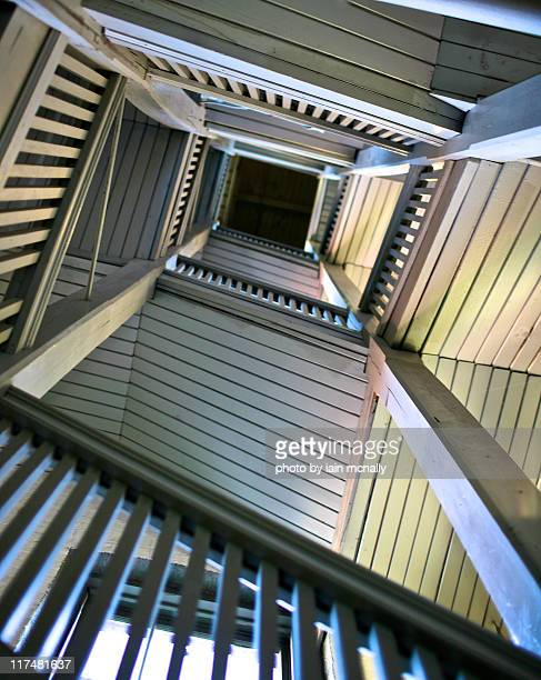looking up stairwell - optical illusion stock photos and pictures