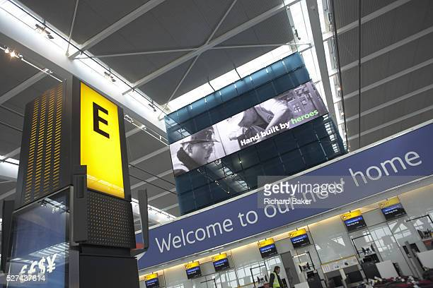 Looking up to the Nokia information screen and 40m high roof of Heathrow airport's Terminal 5 Designed by architects Richard Rogers Partnership the...
