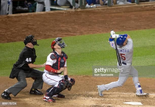 Looking up umpire Ron Kulpa Washington Nationals catcher Matt Wieters and Chicago Cubs center fielder Albert Almora Jr follow the straight up...