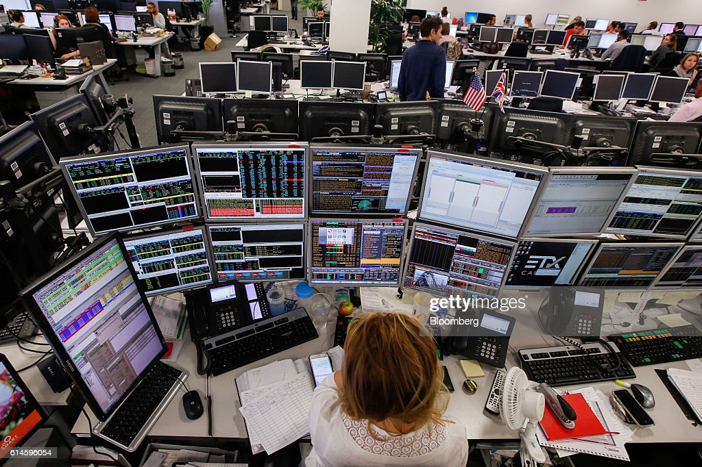 High Quality A Looks At Financial Data On Computer Screens On The Trading Floor At ETX  Capital,