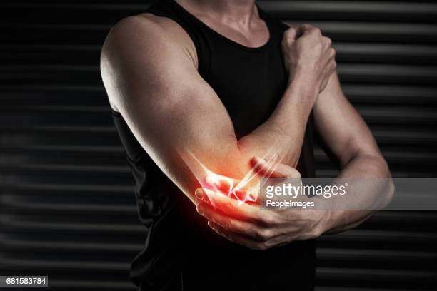 looks like he's done some serious damage to his elbow - pain stock pictures, royalty-free photos & images