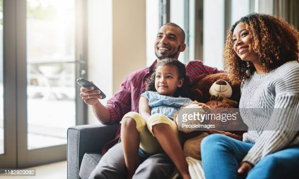 looks like your favourite show is on sweetie - family watching tv stock pictures, royalty-free photos & images
