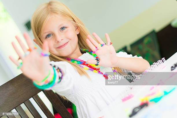 Loom bracelets on a young girl's hand