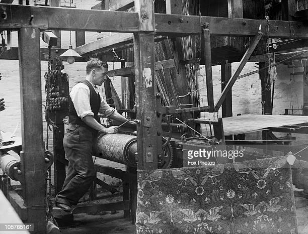 A loom is used to repair an original William Morris design at the Morris Co workshop in Merton Abbey Mills London 23rd March 1931 Morris Co is a...