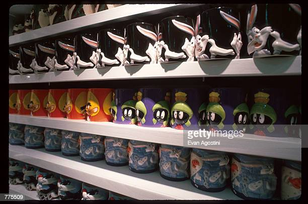 Looney Tunes character mugs are on display at the Warner Bros Studio store October 23 1996 in New York City The store originally a three floor...
