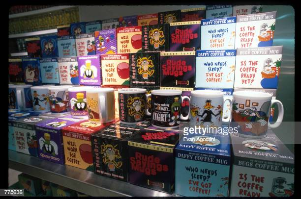 Looney Tunes mugs are on display at the Warner Bros Studio store October 23 1996 in New York City The store originally a three floor specialty store...