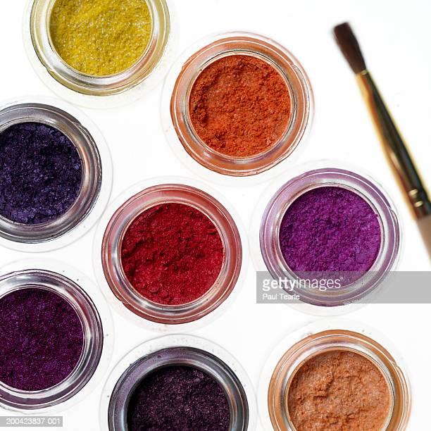 Loose make-up powders and brush, close up